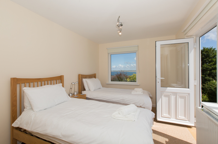 Mordros Carbis Bay Twin Bedroom With Doors Out